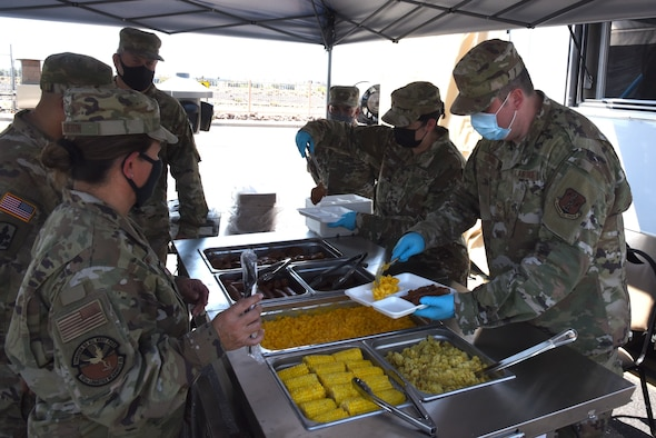 Airmen from 161st Services Squadron, Arizona Air National Guard, serve their first meal cooked in the DRMKT to Arizona Guard leadership, Aug 3, 2021, Goldwater Air National Guard Base, Arizona.  The distinguished guests were first given a brief on the DRMKT capabilities, followed by a quick tour of the trailer in its operational configuration.(U.S. Air Force photo by Tech. Sgt. Anthony Reynolds)