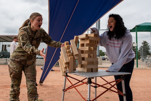 Staff Sgt. Kendra Gorniak, left, a 460th Medical Group medical information systems technician, and Staff Sgt. Elizabeth Black, the Buckley Garrison command chief executive assistant, play Jenga at the 2021 Buckley Connects Day on Buckley Space Force Base, Colo., Sept. 30, 2021.