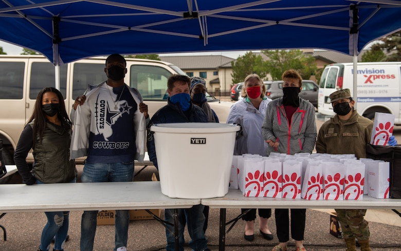 Volunteers give out free food to members of Buckley Space Force Base at the 2021 Buckley Connects Day on Buckley Space Force Base, Colo., Sept. 30, 2021.
