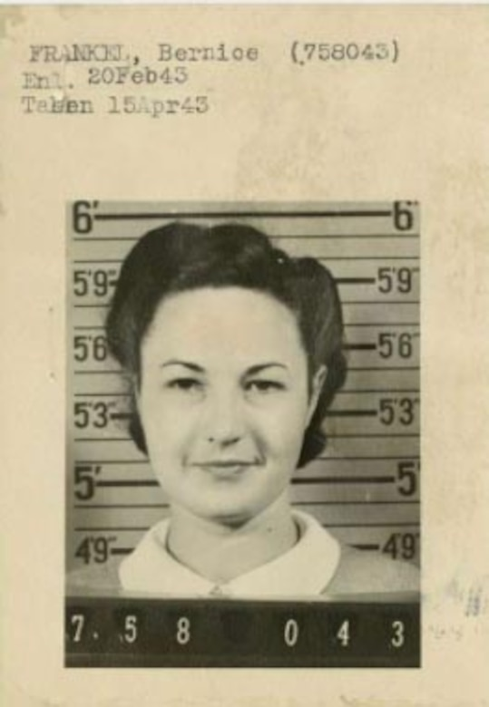 A woman looks at the camera.