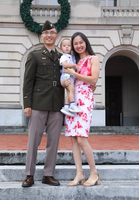 Capt. Tim Wang, officer candidate school instructor at the Wendell H. Ford Regional Training Center (WHFRTC) in Greenville, Ky., poses with his family after a  Officer Candidate School graduation at the state Capitol building in Frankfort, Ky., Sept. 25, 2021. (U.S. Army National Guard photo by Sgt. Jesse Elbouab)