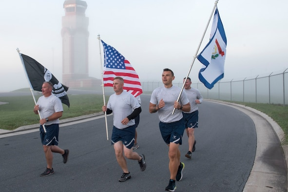 Members of the 167th Civil Engineering Squadron participate in the POW/MIA 12 Hour Remembrance Run/Walk held at the 167th Airlift Wing, Martinsburg, West Virginia, Oct. 2, 2021. Unit members carried the U.S., POW/MIA and West Virginia flag for the duration of the event, starting at 6:00 a.m. and ending at 6:00 p.m., to pay tribute to those who were prisoners of war and those still missing in action.