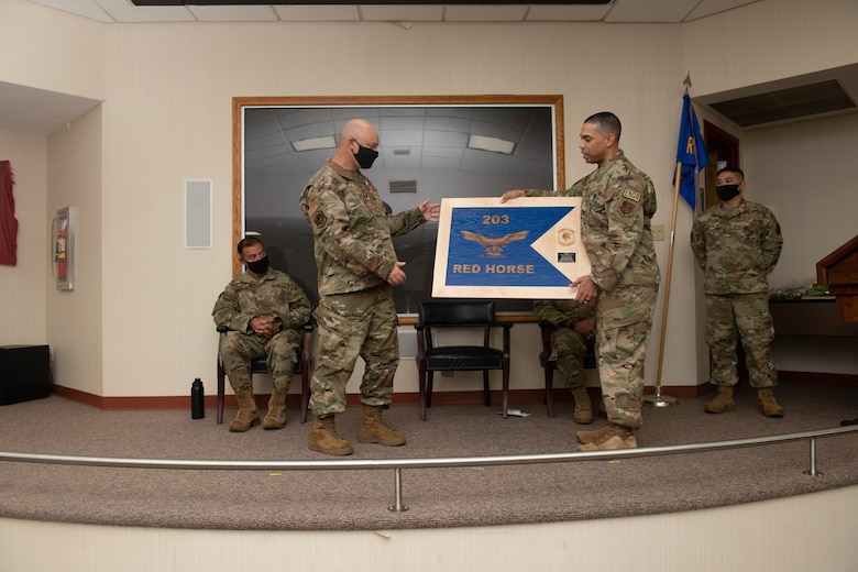 Lt. Col. Jeffrey E. Getz, former 203rd Rapid Engineer Deployable Heavy Operational Repair Squadron Engineers (RED HORSE) commander is presented with mementos during a change of command ceremony Oct. 2, 2021, at State Military Reservation in Virginia Beach, Virginia.