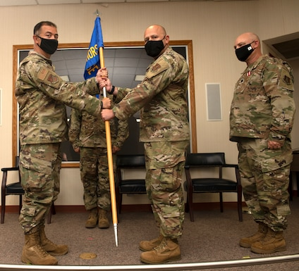 Col. David Lands, 192nd Mission Support Group commander, left, presents the 203rd Rapid Engineer Deployable Heavy Operational Repair Squadron Engineers (RED HORSE) guidon to Maj. Ayad M. Abisaab signifying the start of his command during a change of command ceremony Oct. 2, 2021, at State Military Reservation in Virginia Beach, Virginia.