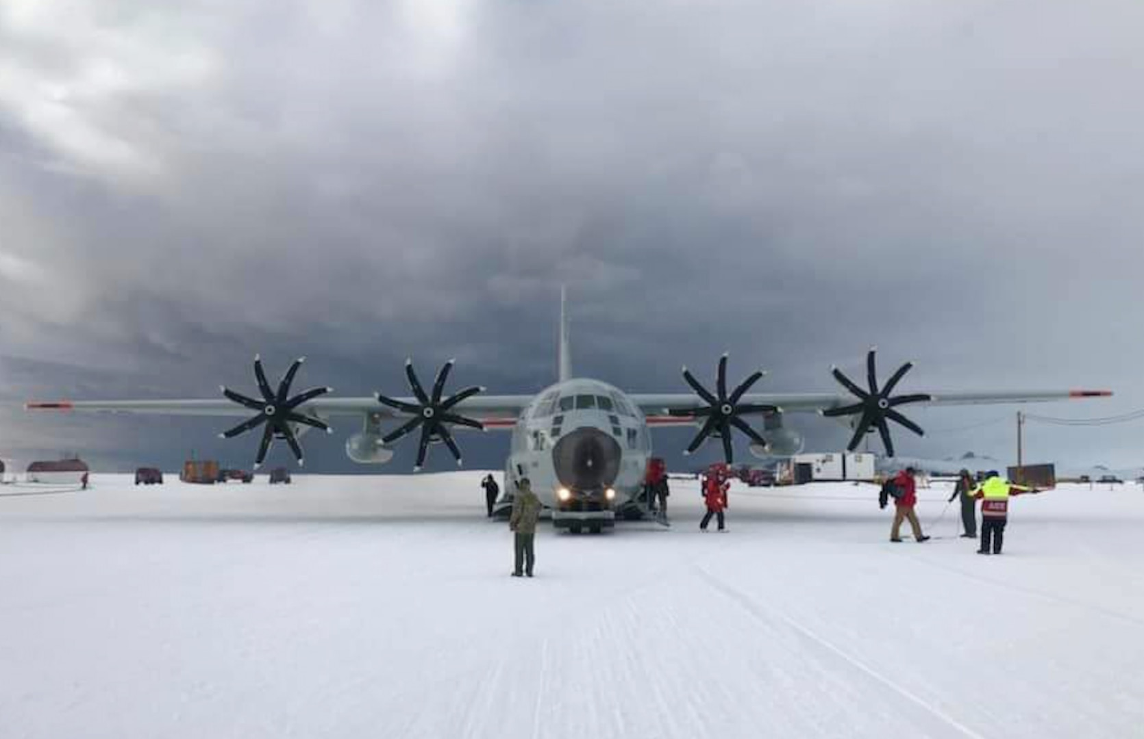"""Airmen prepare for the launch of an LC-130 """"skibird"""" assigned to the New York Air National Guard's 109th Airlift Wing in Antarctica Feb. 8, 2021, during a mission to support National Science Foundation research. The 109th Airlift Wing flies the largest ski-equipped aircraft in the world and will once again support science missions in Antarctica beginning in December 2021."""