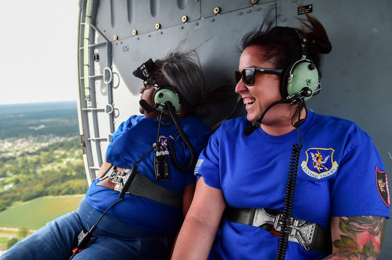 two women in the back of a helicopter
