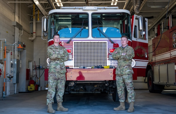 U.S. Air Force Senior Airman Jared Moon (left) poses with his brother, Senior Airman Joel Moon (right), at Hill Air Force Base, Utah on Oct. 3, 2021. The brothers joined the Air Force Reserve together and are currently firefighters with the 419th Civil Engineer Squadron.