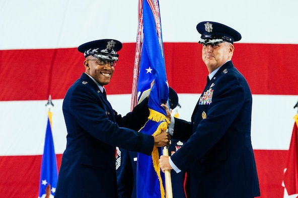 U.S. Air Force Gen. Mike Minihan, right, incoming Air Mobility Command commander, assumes command from Air Force Chief of Staff Gen. CQ Brown, Jr., during the AMC change of command ceremony at Scott Air Force Base, Illinois, Oct. 5, 2021. AMC provides rapid global mobility and sustainment for America's armed forces. (U.S. Air Force Photo by Airman 1st Class Isaac Olivera)