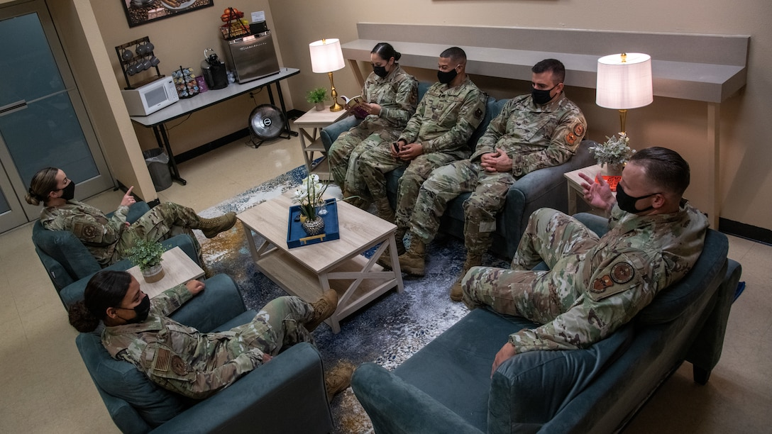 Airmen with the 372nd Training Squadron and 56th Fighter Wing use the Detachment 12 wellness room Sept. 21, 2021, at Luke Air Force Base, Arizona. The wellness room, equipped with a TV, books, paintings and snacks, was created to offer a relaxing space where members can rest, read or study. The newly revived wellness room helps support Airmen and their families by enhancing facilities and equipment to support combat-ready Airmen. (U.S. Air Force photo by Staff Sgt. Collette Brooks)