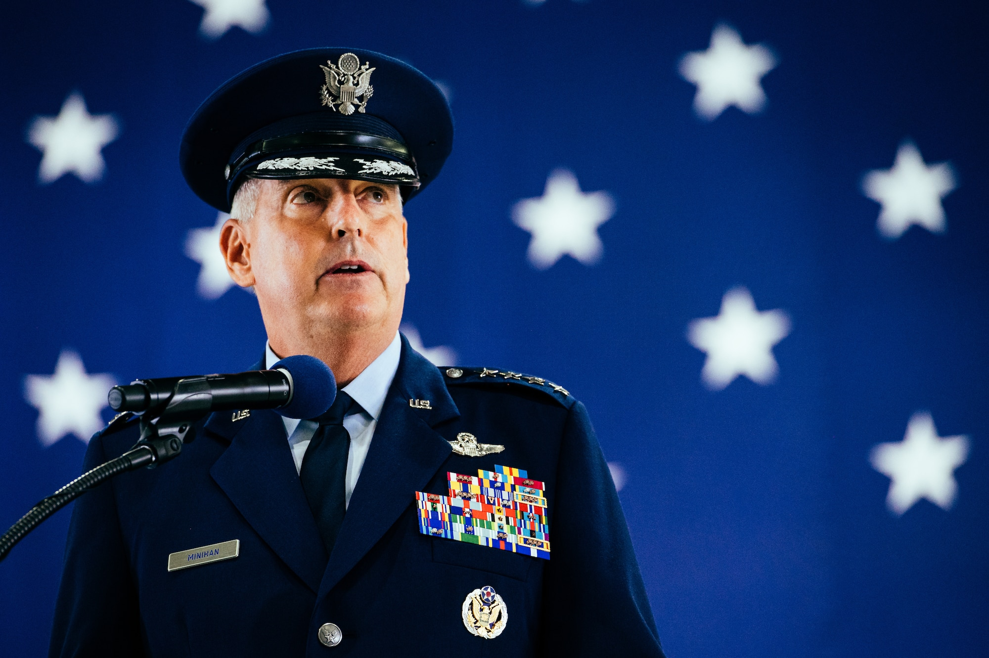 Gen. Mike Minihan, incoming Air Mobility Command commander, gives a speech at Scott Air Force Base, Ill., Oct. 5, 2021. Minihan succeeded Gen. Jacqueline D. Van Ovost.