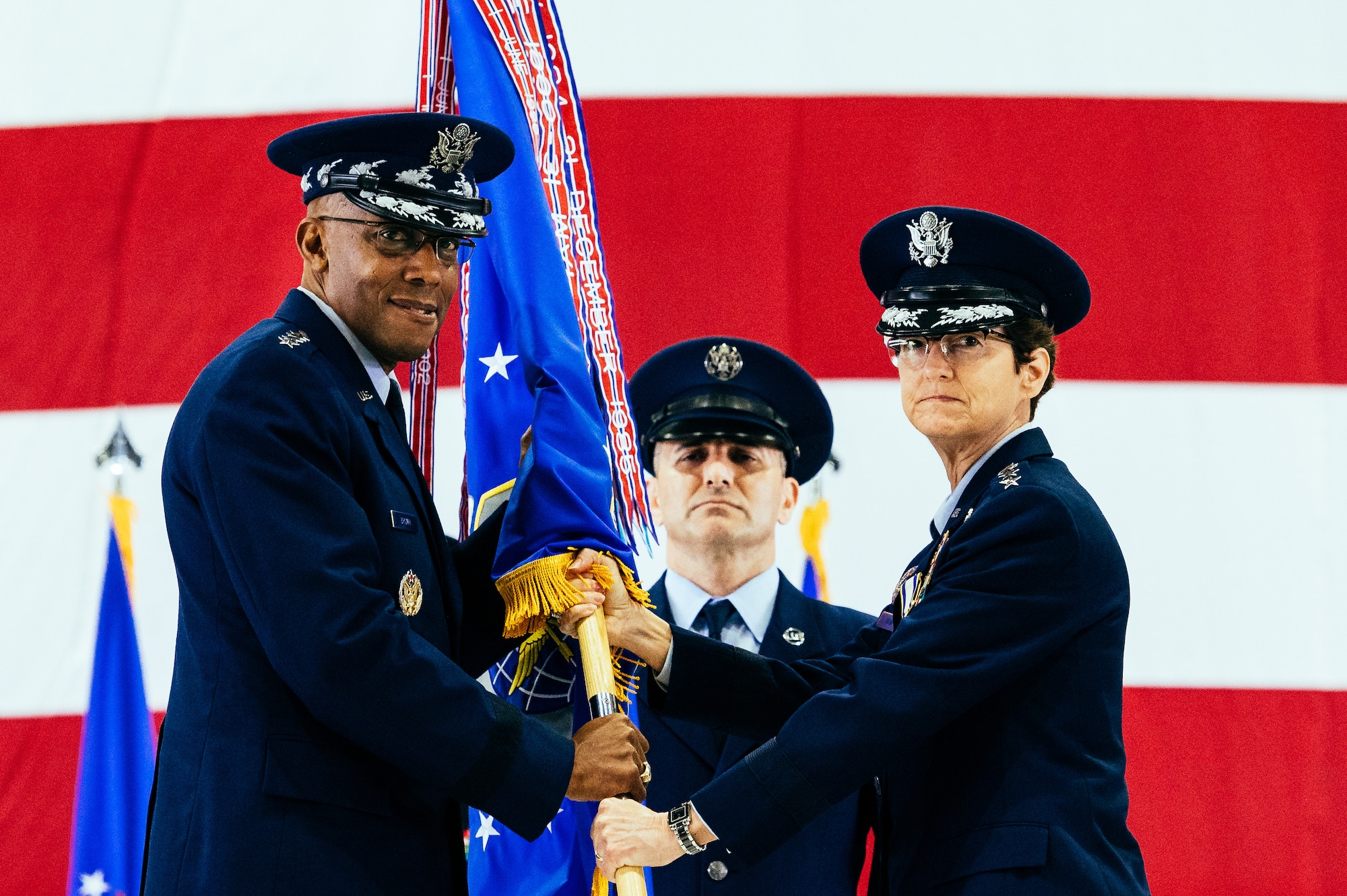 Gen. Jacqueline D. Van Ovost, right, outgoing Air Mobility Command commander, relinquishes command to Air Force Chief of Staff Gen. CQ Brown, Jr., during the AMC change of command ceremony at Scott Air Force Base, Ill., Oct. 5, 2021. AMC provides rapid global mobility and sustainment for America's armed forces.