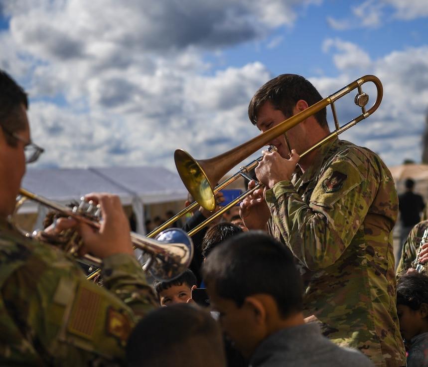 Airman plays the trombone.
