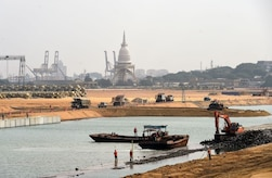 Construction vehicles work on a land reclamation project in Colombo, Sri Lanka.