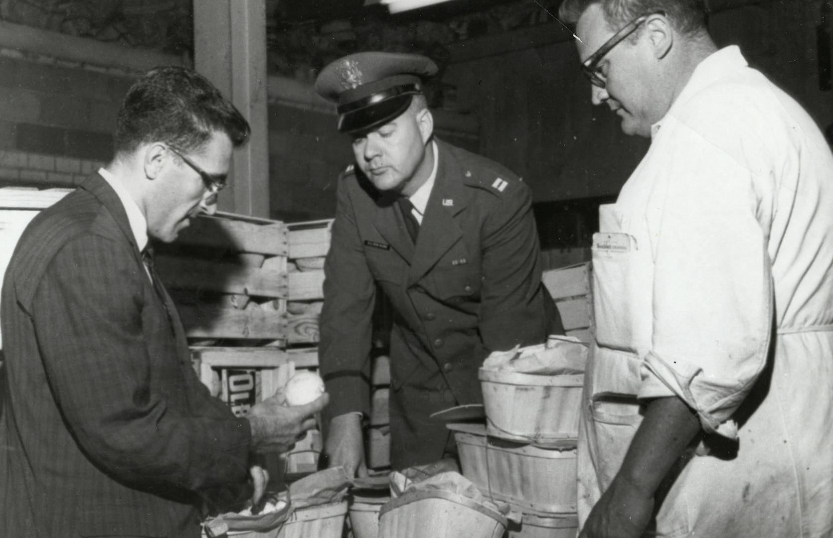 Three gentlemen conduct a food inspection.