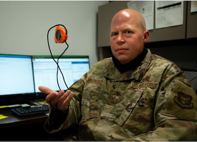 U.S. Air Force Senior Master Sgt. Jason Billingsley, the superintendent for the 442d Sustainment Services Flight, is photographed with a stopwatch Oct. 3, 2021 on Whiteman Air Force Base, Mo. Billingsley led a virtual training about the new myFitness platform used by fitness program managers to schedule tests, run reports, and keep track of results and exemptions. (U.S. Air Force photo by Tech. Sgt. Missy Sterling)