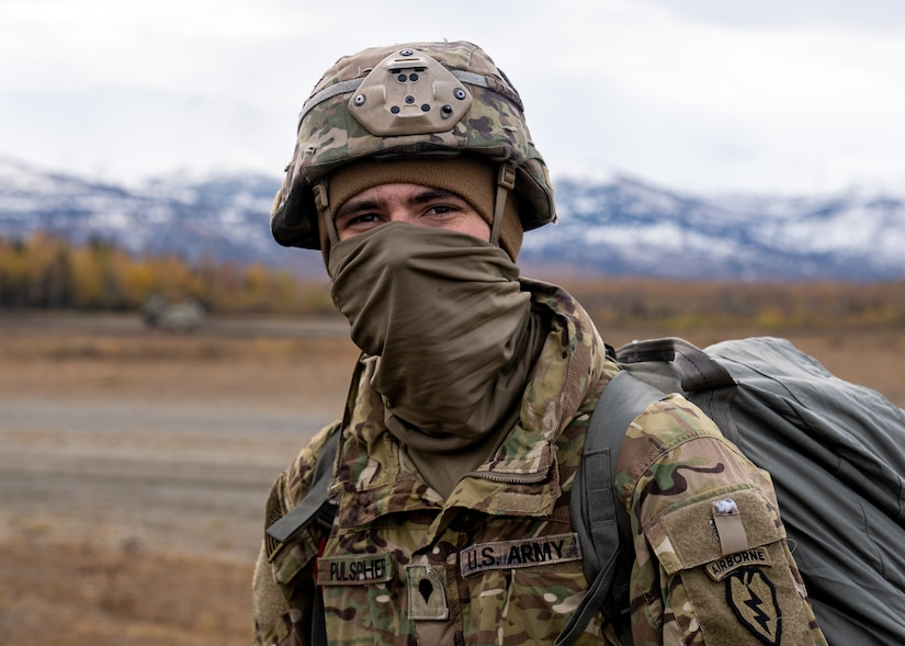 U.S. Army Spc. Chris Pulsipher, a paratrooper assigned to the 1st Squadron (Airborne), 40th Cavalry Regiment, 4th Infantry Brigade Combat Team (Airborne), 25th Infantry Division, U.S. Army Alaska, smiles after successfully jumping from a CH-47 Chinook.