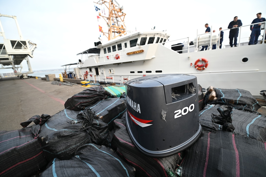 A pile of seized drugs, estimated to be $96 million, is transferred off the Coast Guard Cutter Forest Rednour in San Diego, Sept. 24, 2021.