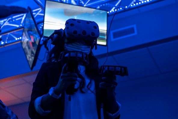 A militiary spouse uses the virtual reality system.