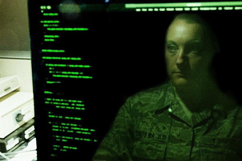 An employee looks at a computer screen.
