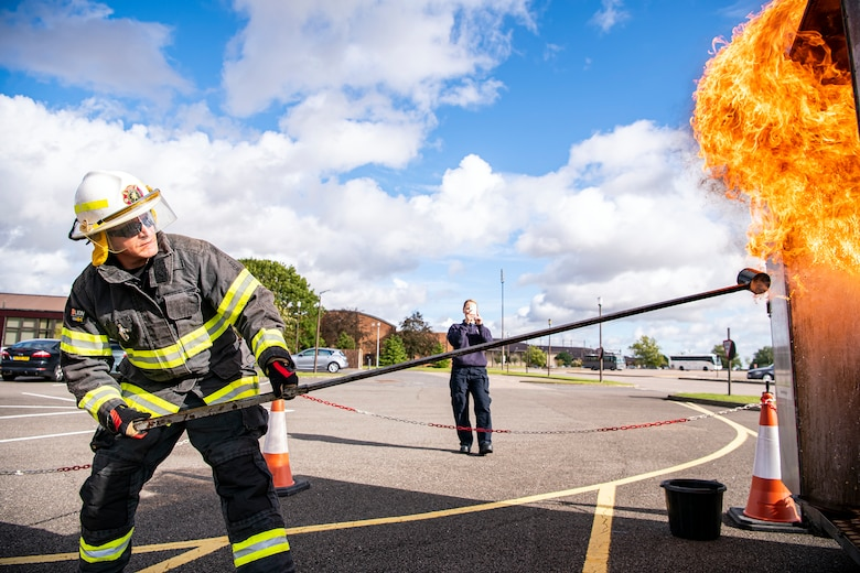 Dave Herman, 423rd Civil Engineer Squadron assistant chief of fire prevention, demonstrates a grease fire during a safety briefing at RAF Alconbury, England, Oct. 4, 2021. The demonstration was a part of Fire Prevention Week which allowed firefighters from the 423rd CES to educate Airmen and family members from the 501st Combat Support Wing on proper fire safety habits. (U.S. Air Force photo by Senior Airman Eugene Oliver)