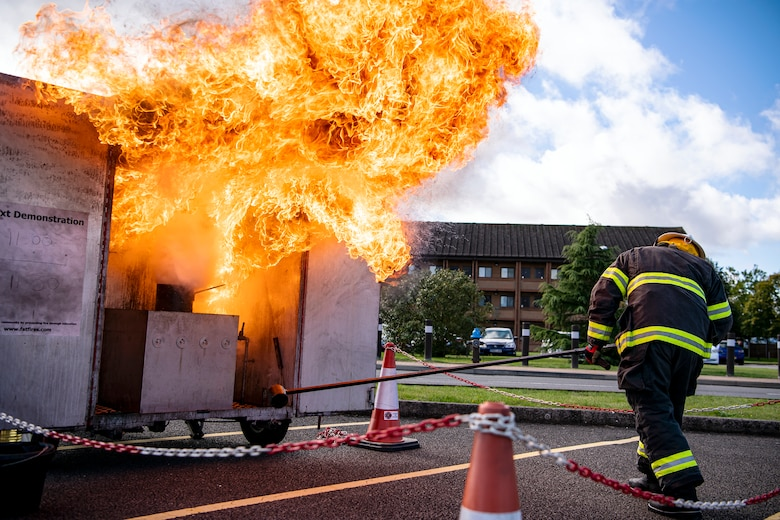 Dave Herman, 423rd Civil Engineer Squadron assistant chief of fire prevention, demonstrates a grease fire during a safety briefing at RAF Alconbury, England, Oct. 4, 2021.The demonstration was a part of Fire Prevention Week which allowed firefighters from the 423rd CES to educate Airmen and family members from the 501st Combat Support Wing on proper fire safety habits. (U.S. Air Force photo by Senior Airman Eugene Oliver)
