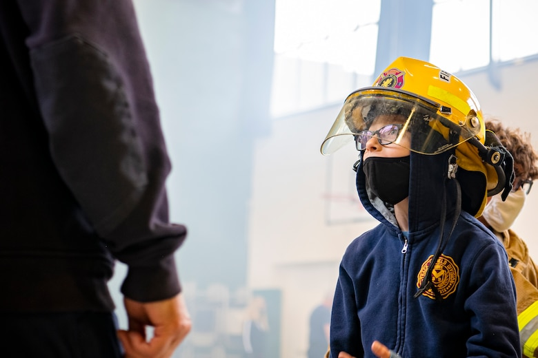 A student from Alconbury Elementary school participates in a fire station open house at RAF Alconbury, England, Oct. 7, 2021. The open house was a part of Fire Prevention Week which allowed firefighters from the 423rd CES to educate Airmen and family members from the 501st Combat Support Wing on proper fire safety habits. (U.S. Air Force photo by Senior Airman Eugene Oliver)