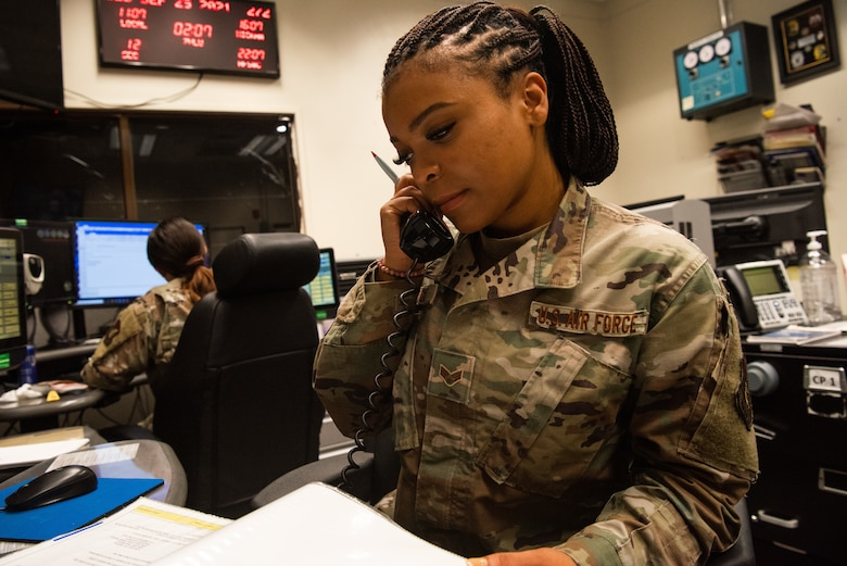 Senior Airman D'Eryka Corpuz, 51st Fighter Wing Command Post emergency action controller, completes a checklist Sept. 30, 2021, at Osan Air Base, Republic of Korea.