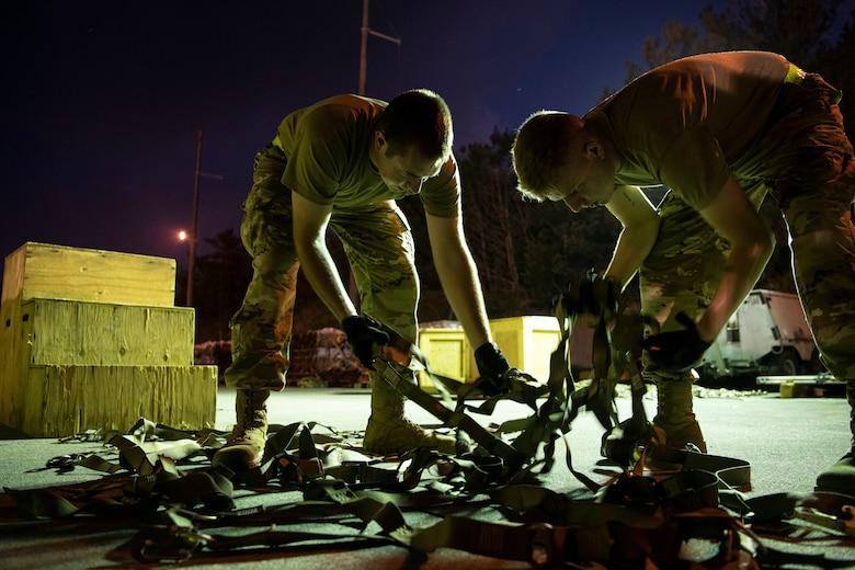 Two 18th MUNS Airmen build pallets