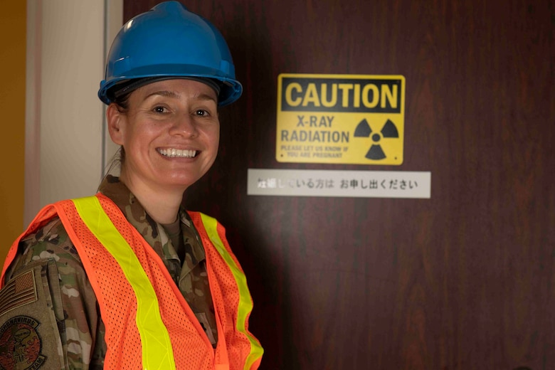 Lt. Col. Lisa Guzman, 374th Medical Support Squadron commander, stands in front of a computerized tomography room during an inspection at Yokota Air Base, Japan, Oct. 8, 2021.