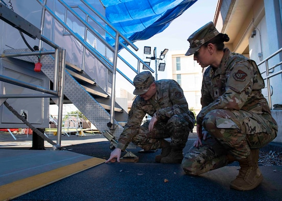 Master Sgt. Connor Galvin, 374th Medical Support Squadron section chief inventory control, left, conducts a safety inspection with Lt. Col. Lisa Guzman, 374th MDSS commander, at Yokota Air Base, Japan, Oct. 8, 2021.