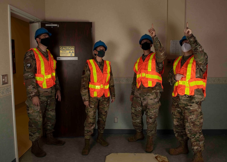 Lt. Col. Lisa Guzman, 374th Medical Support Squadron commander, left middle, inspects a computerized tomography room at Yokota Air Base, Japan, Oct. 8, 2021.