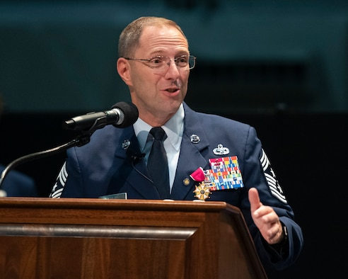 Chief Master Sgt. Stanley Cadell, Air Force Materiel Command command chief, delivers parting remarks during his retirement ceremony Oct. 1, 2021, at Wright-Patterson Air Force Base, Ohio. Cadell retired after 30 years on active duty. (U.S. Air Force photo by R.J. Oriez)