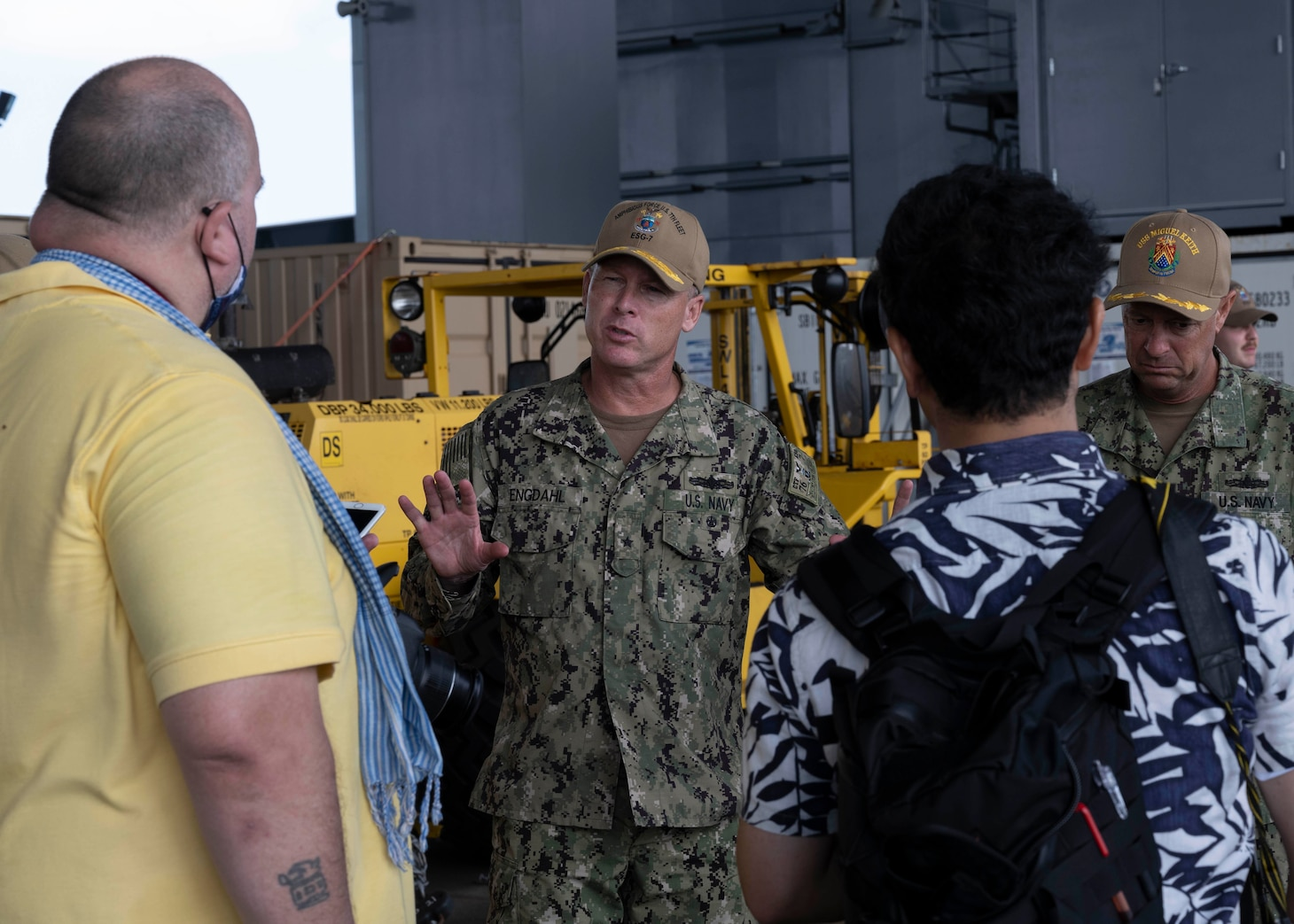 WHITE BEACH, Japan (Oct. 6, 2021) Rear Adm. Chris Engdahl,commander, Expeditionary Strike Group 7, speaks with local media aboard Lewis B. Puller-class expeditionary staging base USS Miguel Keith (ESB 5) to local media  Oct. 6, 2021. Miguel Keith, assigned to Amphibious Squadron Eleven, is operating in the U.S. 7th Fleet area of responsibility to enhance interoperability with allies and partners and serve as a ready response force to defend peace and stability in the Indo-Pacific region. (U.S. Navy photo by Mass Communication Specialist 2nd Class Jessica Ann Hattell)