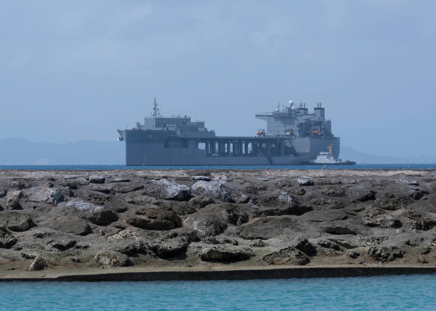 WHITE BEACH, Japan (Oct. 6, 2021) Lewis B. Puller-class expeditionary staging base USS Miguel Keith (ESB 5) anchors off Commander, Fleet Activities Okinawa White Beach Naval Facility Oct. 6, 2021. Miguel Keith, assigned to Amphibious Squadron Eleven, is operating in the U.S. 7th Fleet area of responsibility to enhance interoperability with allies and partners and serve as a ready response force to defend peace and stability in the Indo-Pacific region. (U.S. Navy photo by Mass Communication Specialist 2nd Class Jessica Ann Hattell)