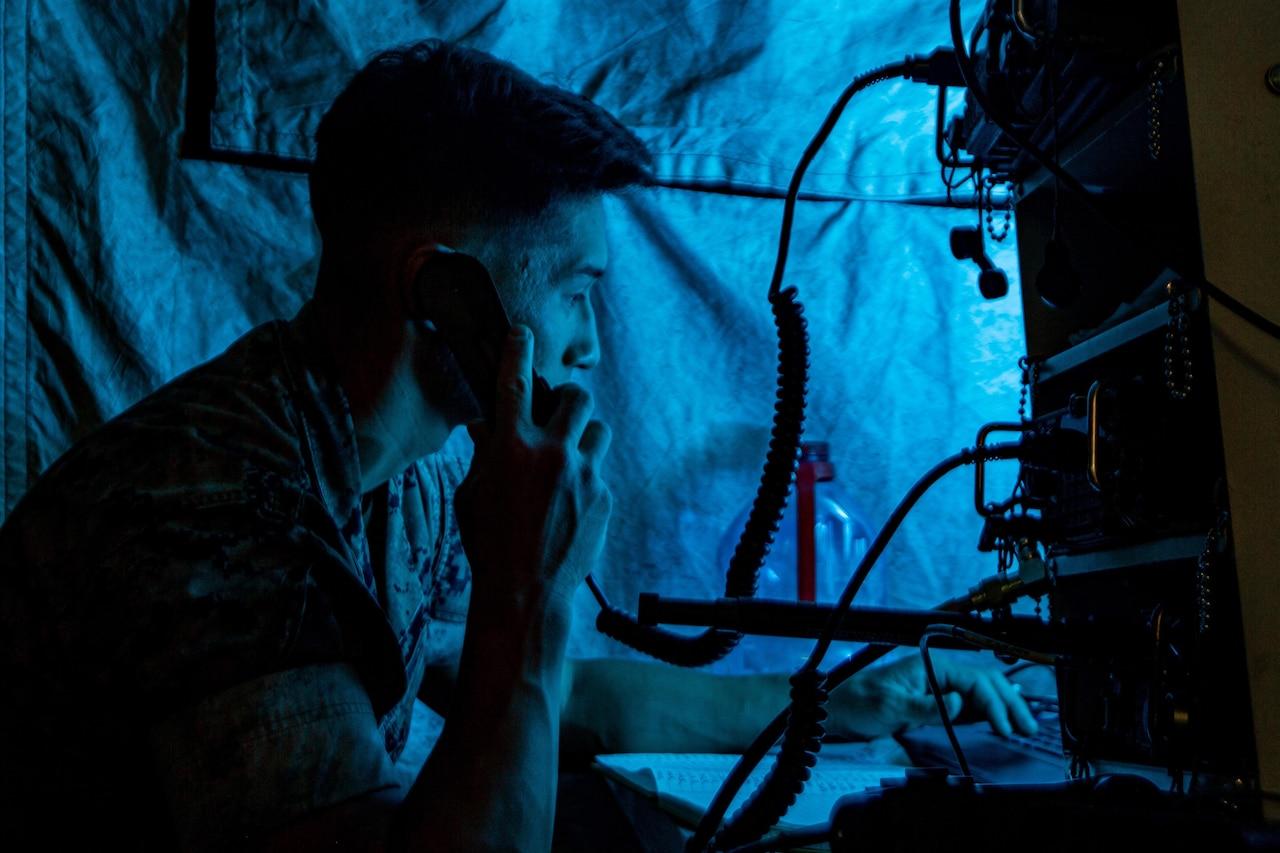 A Marine operates communications gear.