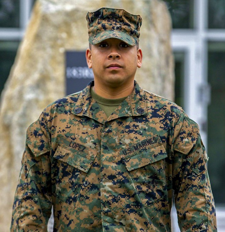 U.S. Marine Corps Staff Sgt. Daniel M. Lopez, an ammunition chief with the 26th Marine Expeditionary Unit, poses for a photo after being recognized as the motivator of the week on Fort Pickett, Virginia, Oct. 7, 2021. Lopez was recognized for his successes in managing manpower changes in preparation for Operation Allies Welcome. He maintained accountability for more than 100 Marines, managed water distribution throughout Fort Pickett, set up tents for the medical screening process, and ensured service members had access to basic necessities.