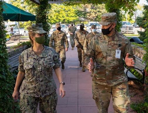 Navy Rear Adm. Kristen Fabry; Air Force Col. Christian Lyons