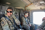 Command Sgt. Maj. Javier Acosta and Brig. Gen. Charles Hausman on helicopter flight while deployed to Iraq in 2019.