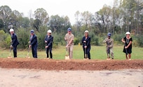 7 people pose with shovels for a groundbreaking