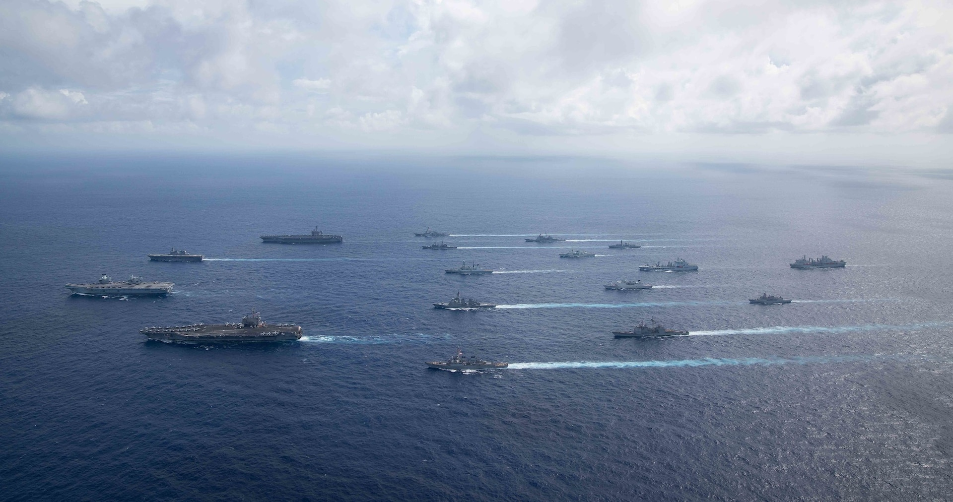 Multiple allied carrier strike groups operate together in 7th Fleet