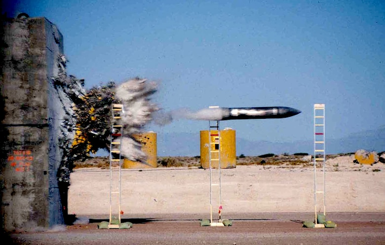 A payload penetrates a concrete target during impact testing at the Holloman High Speed Test Track at Holloman Air Force Base, New Mexico. The HHSTT is operated by the 846th Test Squadron, a unit of the 704th Test Group of the Arnold Engineering Development Complex, headquartered at Arnold Air Force Base, Tenn. Personnel in the 846 TS are currently exploring the modernization of test track to extend its lifespan and further aid in the development of hypersonic systems. (U.S. Air Force photo)