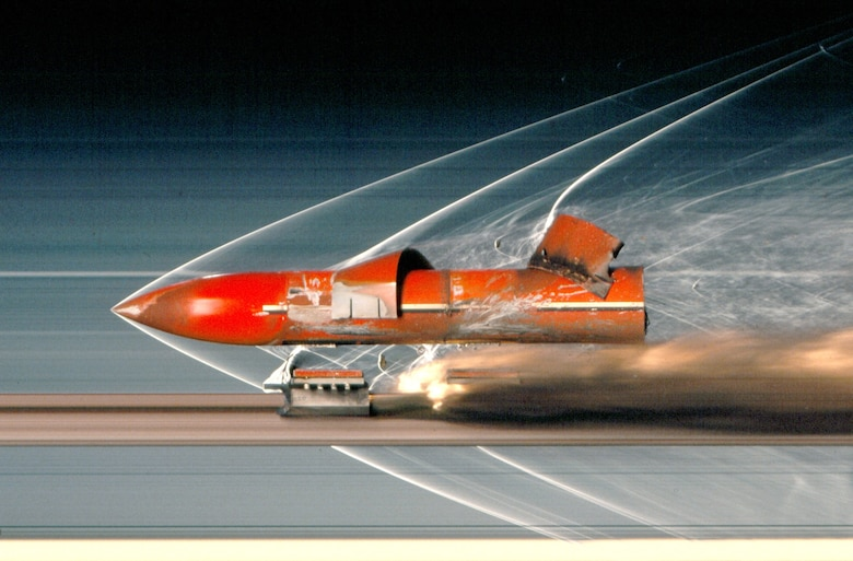 A penetrating payload speeds down the Holloman High Speed Test Track at Holloman Air Force Base, New Mexico, toward an intended target during impact testing, which is among the various types of tests performed at the HHSTT. The test track is operated by the 846th Test Squadron, a unit of the 704th Test Group of the Arnold Engineering Development Complex, headquartered at Arnold Air Force Base, Tenn. Personnel in the 846 TS are currently exploring the modernization of 71-year-old test track to extend its lifespan and further aid in the development of hypersonic systems. (U.S. Air Force photo)