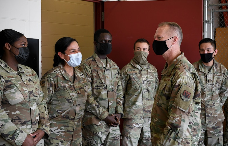 U.S. Air Force Gen. Mark Kelly, commander of Air Combat Command, stops to speak with Airmen from the 319th Medical Group during his visit to Grand Forks Air Force Base, N.D., Oct. 7, 2021. During his visit, Kelly met with Airmen from across the base to learn about their role in the Air Force mission and discuss ACC objectives. (U.S. Air Force photo by Airman 1st Class Ashley Richards)