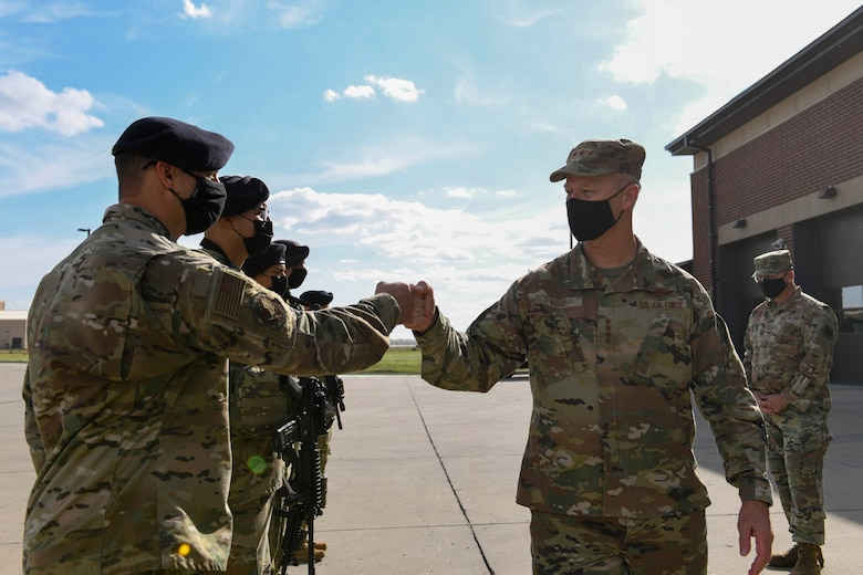 U.S. Air Force Gen. Mark Kelly, commander of Air Combat Command, fist bumps Airmen from the 319th Security Forces Squadron during a visit to Grand Forks Air Force Base, N.D., Oct. 7, 2021. Kelly took the opportunity to express his gratitude and acknowledge the Airmen's hard work and dedication to protecting people and assets on a daily basis. (U.S. Air Force photo by Airman 1st Class Ashley Richards)