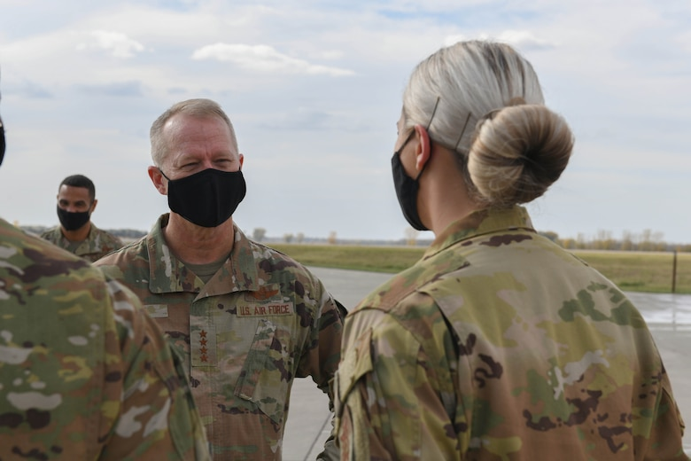 U.S. Air Force Gen. Mark Kelly, commander of Air Combat Command, talks with 319th Civil Engineer Squadron firefighter Senior Airman Baylee Govier after a demonstration by the base fire department on Grand Forks Air Force Base, N.D., Oct. 7, 2021. During his visit to Grand Forks AFB, Kelly interacted with Airmen from across the installation to learn about their role in the Air Force mission and discuss ACC objectives. (U.S. Air Force photo by Airman 1st Class Ashley Richards)
