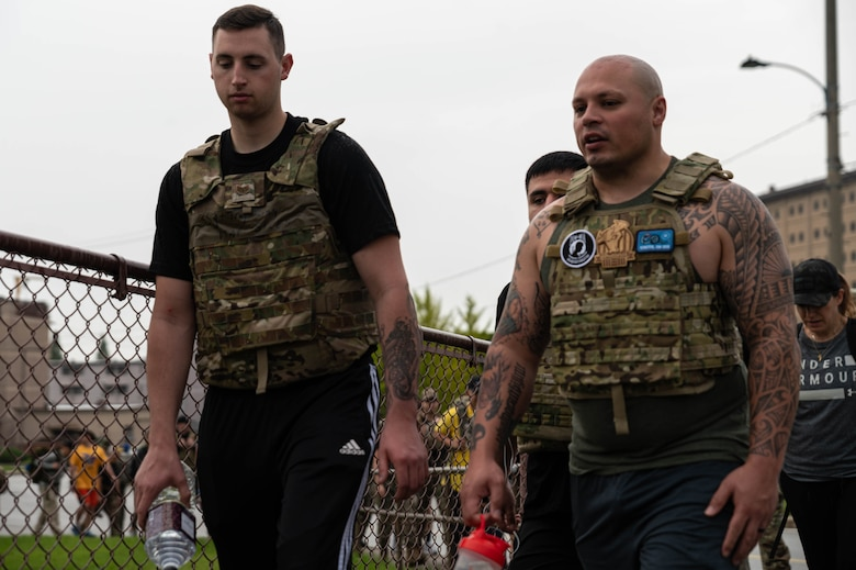 Airmen begin a 3-mile ruck march hosted by 51st Security Forces Squadron