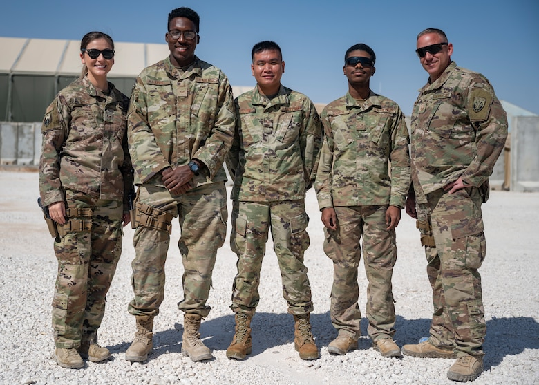 Joint Expeditionary Tasked/Individual Augmentees members for the Special Operations Forces Logistics Element pose for a group photo at Al Asad Air Base, Iraq, Sept. 25, 2021.