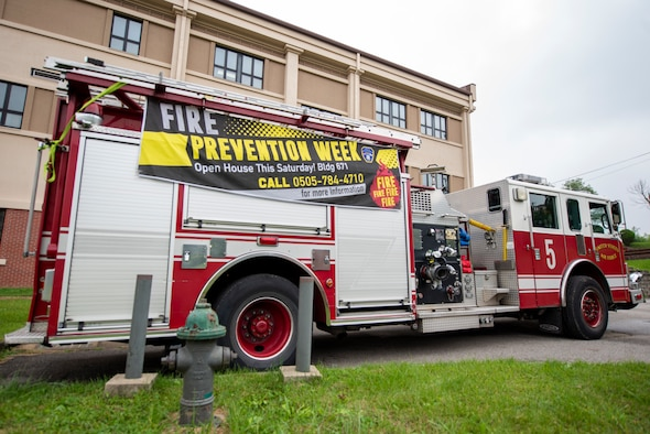 51st Civil Engineer Squadron firemen display one of their firetrucks for Osan Air Base families during the Fire Prevention Week Kids' Showcase