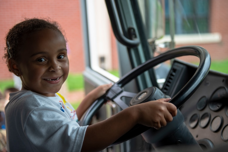A child attendee tours a 51st Civil Engineer Squadron firetruck during the Fire Prevention Week's Kids Showcase