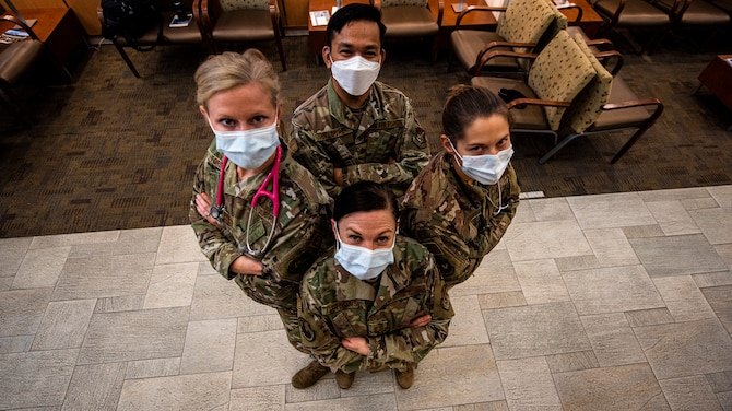 A group of physician assistants stand ready